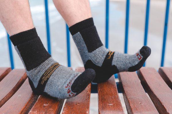 Boot sock possum merino graphite model toes up bench
